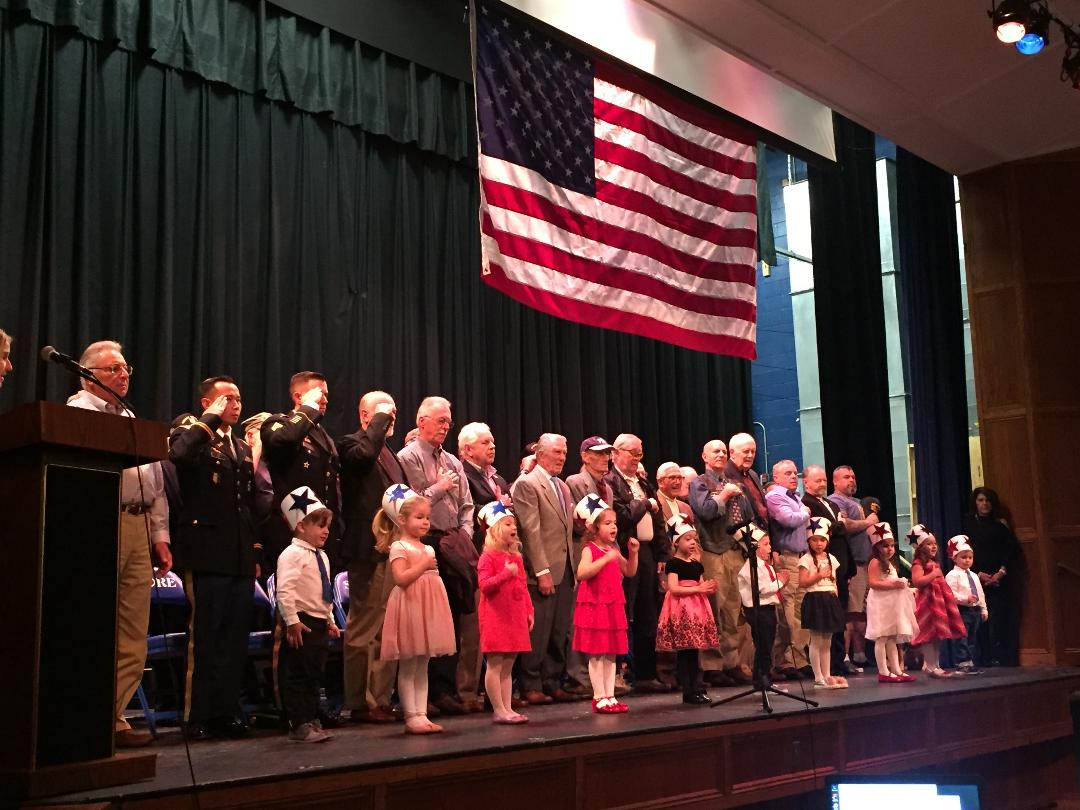 Veterans and students from The Gingerbread House lead SRHS in the flag salute