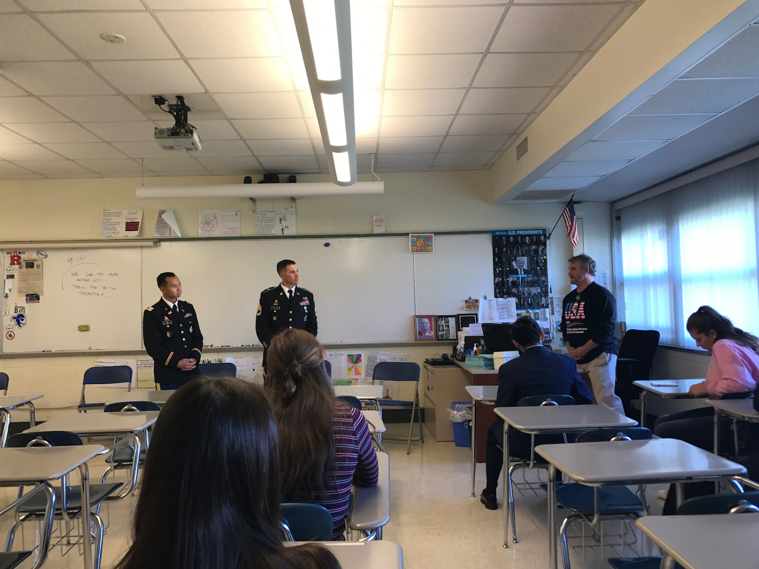 Students in C11 listen to veterans with discussion guided by Social Studies department member, Mr. Costantino